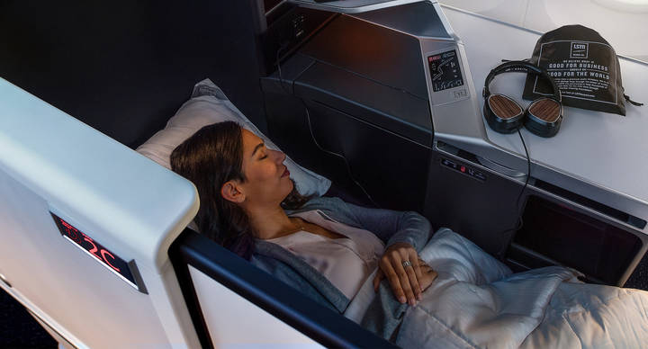 Person sleeping on Delta Air Lines plan