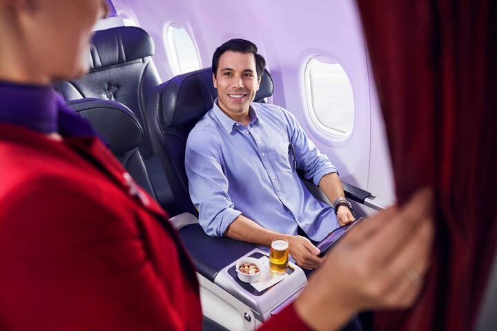 Virgin Australia Passanger seated in an Economy X Seat