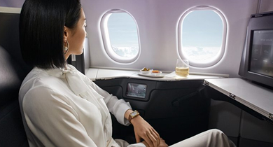 Person enjoying 'The Business' on board a Virgin Australia aircraft