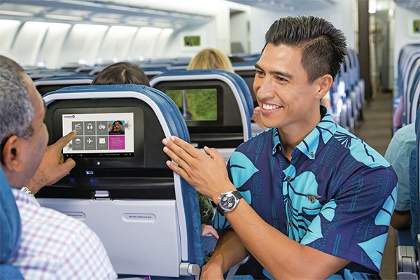 Hawaiian airlines host assisting a passenger