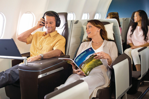 Couple on a Hawaiian Airlines business class