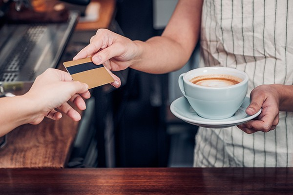 Handing a card in exchange for a coffee