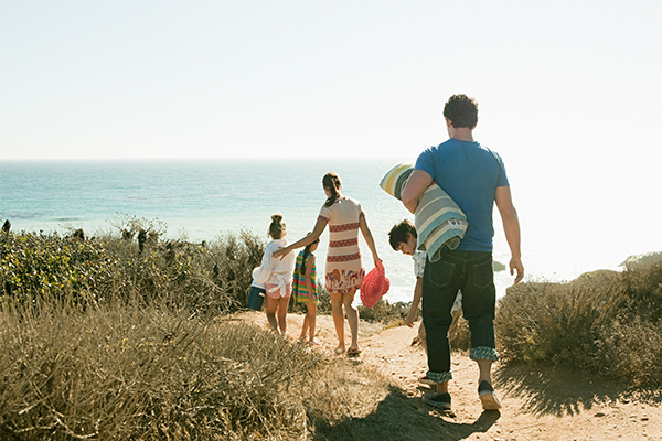 A family on their way to the beach