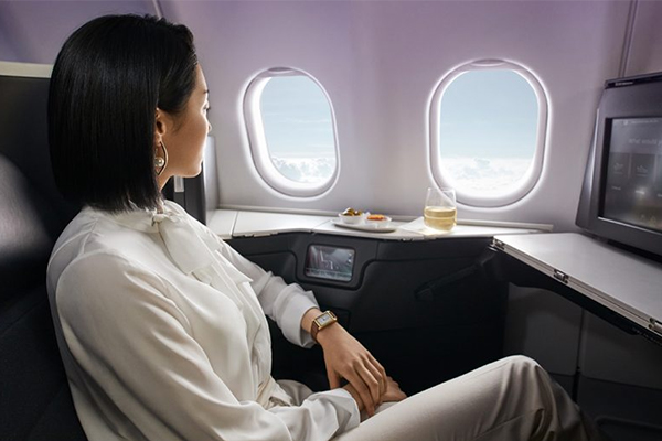 A woman looking out of an airoplane window