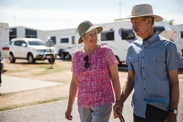 Couple walk through a caravan park