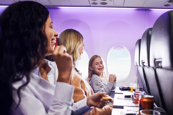 familly with Kid enjoying a Virgin Australia flight