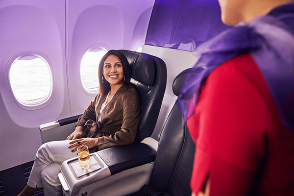 Lady enjoying Virgin Australia's Business Class